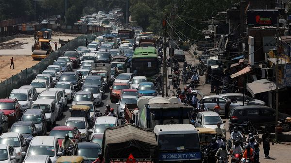 Vehicles queue at the traffic light on an under construction road, after few restrictions were lifted during an extended lockdown to slow the spreading of the coronavirus disease (COVID-19), in New Delhi. (Representational File Photo) (REUTERS)