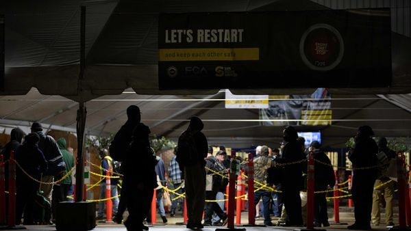 File photo: Employees line up at the entry social distancing barriers inside a tent before the first day back at work at the Fiat Chrysler Automobiles Warren Truck Assembly Plant in Warren, Michigan, U.S. (Bloomberg)