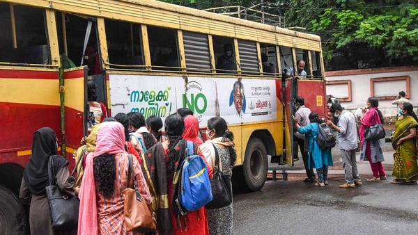 File photo: Kerala High Court employees board a bus, arranged for them, as offices open during the fourth phase of Covid-19 lockdown, in Kochi. (PTI)
