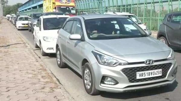 With more and more vehicles returning to the roads, the concept of car sanitisation is picking up. (This photo of a traffic jam on Delhi-Noida border on May 20 morning is used for representational purpose) (ANI)