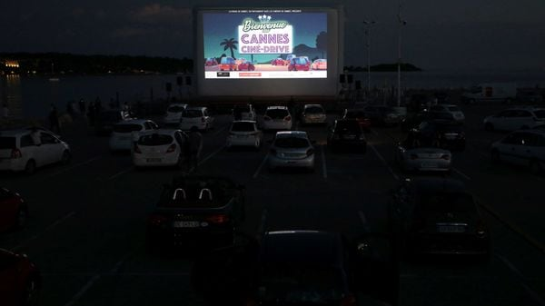 People sit in their cars to watch the movie - E.T. the Extra-Terrestrial - by Steven Spielberg at a drivein cinema at la Pointe Croisette, during the coronavirus disease outbreak, in Cannes, France. (REUTERS)