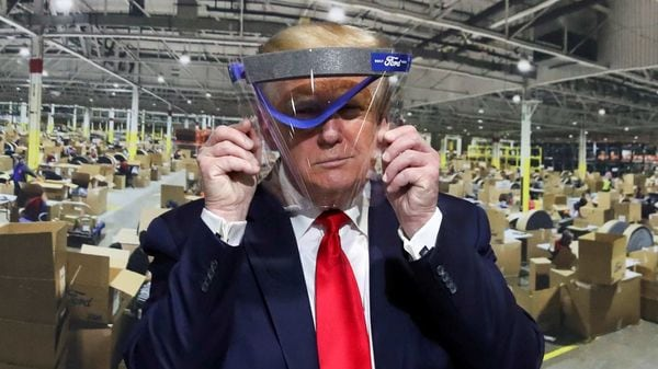 US President Donald Trump only briefly wore a face mask during his visit to a Ford manufacturing facility. (REUTERS)