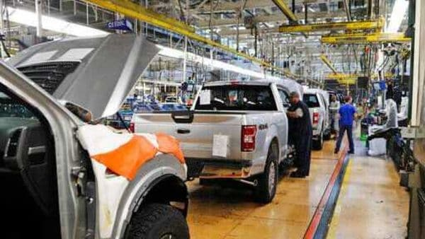 File photo: United Auto Workers assemblymen work on a 2018 Ford F-150 trucks being assembled at the Ford Rouge assembly plant in Dearborn. (AP)