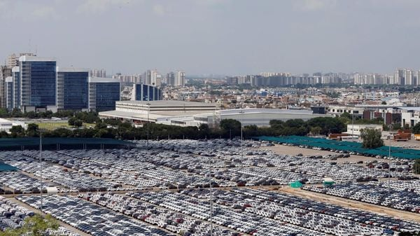FILE PHOTO: Cars are seen parked at Maruti Suzuki's plant at Manesar, in Haryana, (REUTERS)
