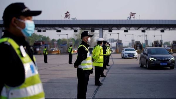 File photo: Police officers stand guard at a toll station of an expressway after travel restrictions to leave Wuhan, the capital of Hubei province and China's epicentre of the novel coronavirus disease (COVID-19) outbreak, were lifted. (REUTERS)