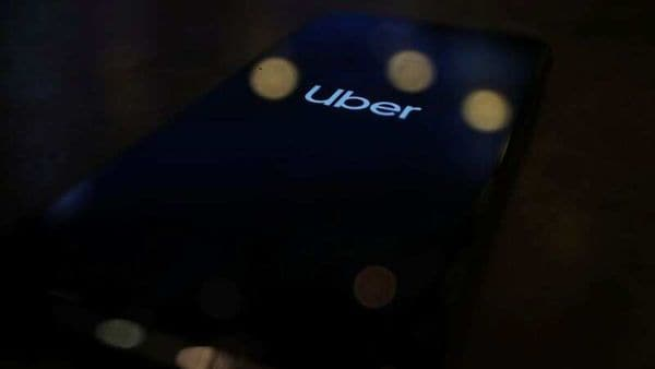 FILE PHOTO: The Uber logo is displayed on a mobile phone in this picture illustration. (REUTERS)