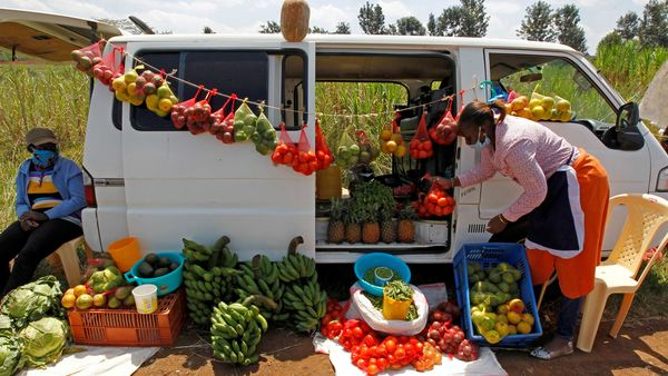 A motorist arranges fruits and vegetables for sale next to her vehicle, as an alternative mobile grocery stall, along the highway, following a lockdown due to the coronavirus disease (COVID-19) outbreak, on the outskirts of Nairobi. (REUTERS)