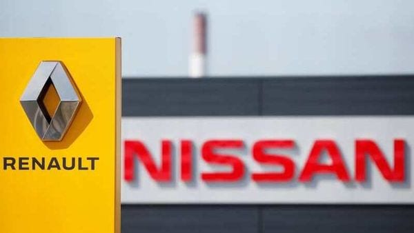 FILE PHOTO: The logos of car manufacturers Renault and Nissan are seen in front of dealerships of the companies in Reims, France,. (REUTERS)