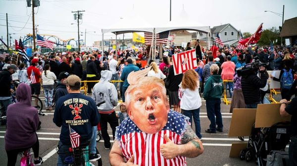 File photo: A protester wears a mask of US president Donald Trump as people take part in a protest to reopen all businesses. (REUTERS)