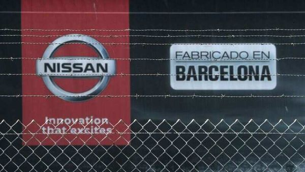 The logo of Nissan is seen through a fence at Nissan factory at Zona Franca. (REUTERS)