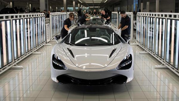 A McLaren 720S is seen on a production line as Britain's Prince William, Duke of Cambridge tours the factory floor in Woking, west of London. (AFP)