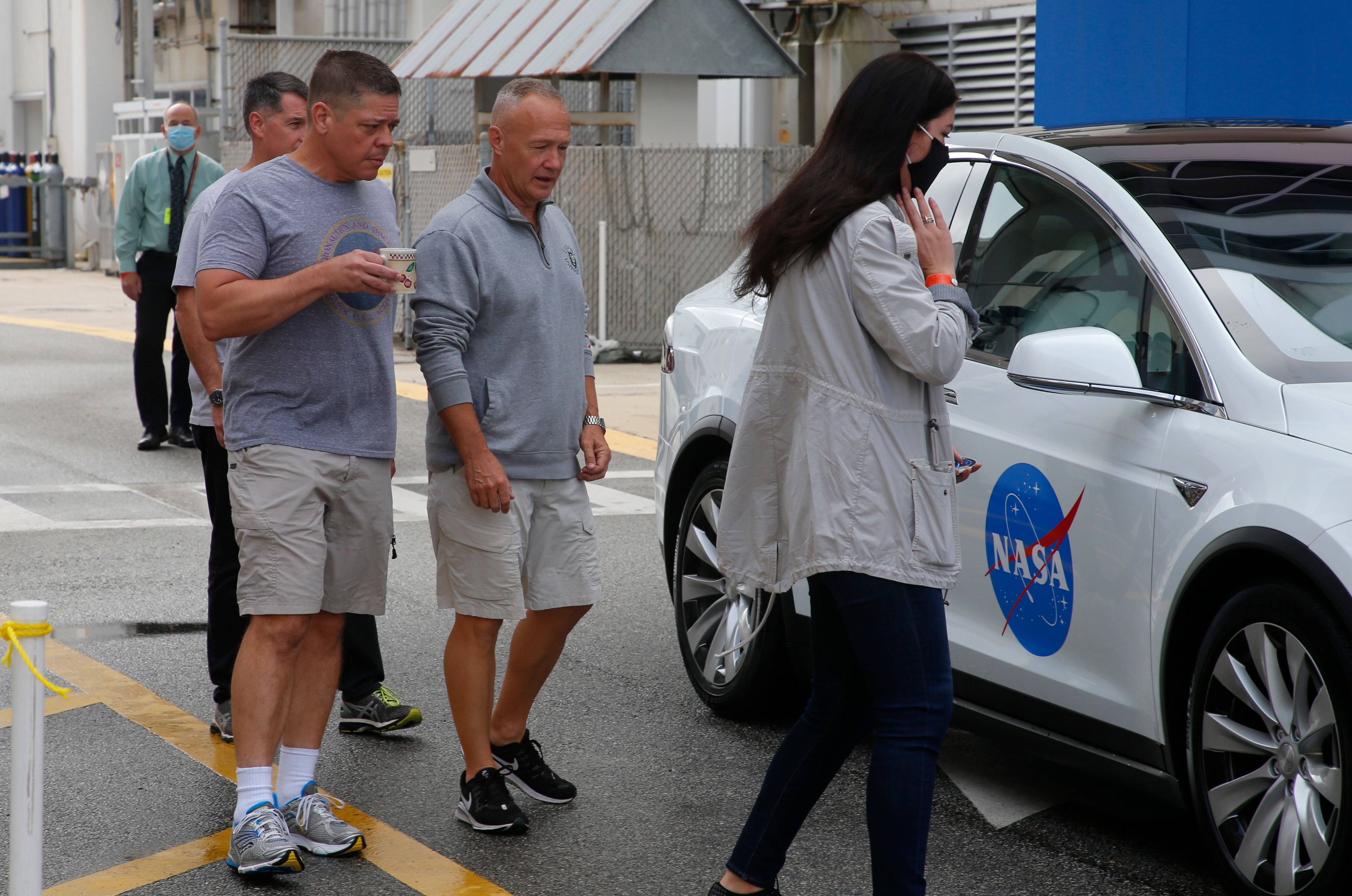 NASA astronauts Douglas Hurley and Robert Behnken arrive to place decals on their crew car, before their NASA SpaceX Demo-2 mission to the International Space Station. (REUTERS)