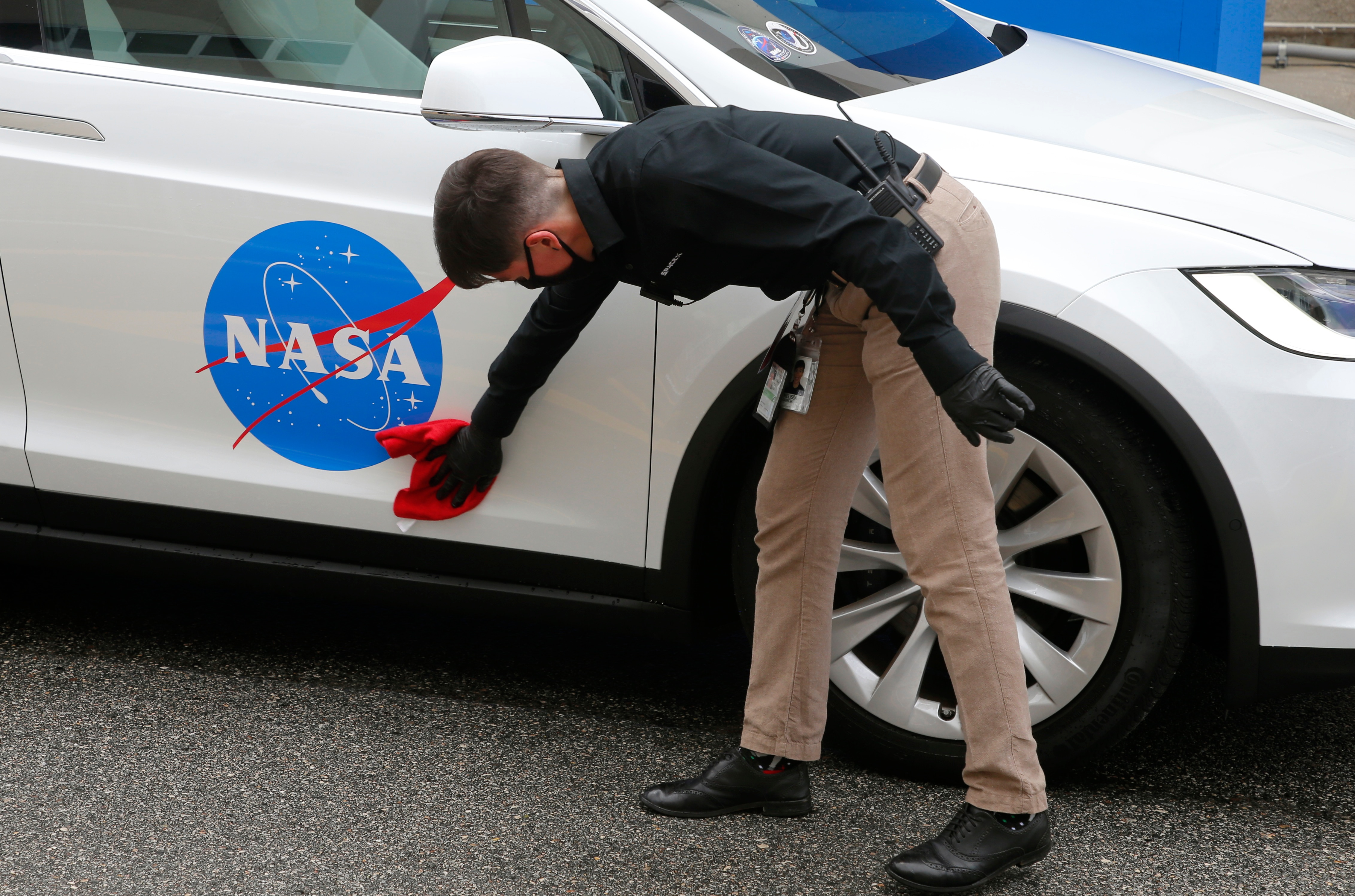 The crew car of the NASA astronauts is polished before the launch of a SpaceX Falcon 9 rocket. (REUTERS)