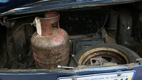 File photo: A cooking gas canister is pictured at the trunk of a car, which runs with cooking gas instead of fuel, as Venezuelans are struggling to cope with chronic fuel shortage. (REUTERS)