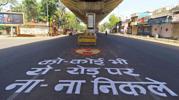 A view of graffiti on a road to raise awareness about the COVID-19 during the nationwide lockdown against the coronavirus pandemic, in Jaipur.