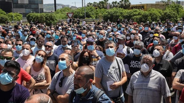 Thousands of masked workers gathered around Nissan's Barcelona factory and blocked the area surrounding it while shouting