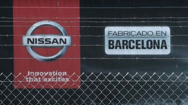File photo: The logo of Nissan is seen through a fence at Nissan factory at Zona Franca. (REUTERS)