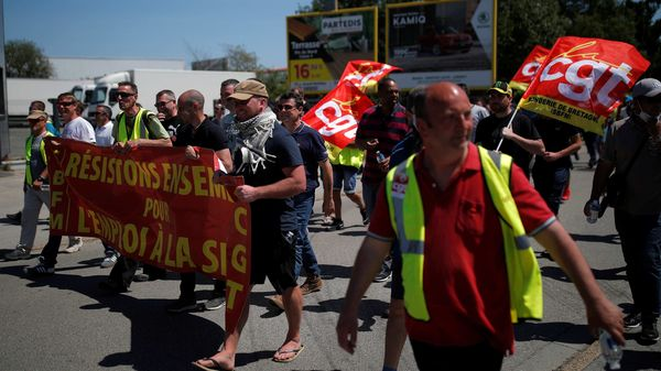 Employees on strike of the Fonderie de Bretagne plant, a subsidiary of Groupe Renault, hold CGT labour union flags during a demonstration against the possible closure of their plant in Caudan, France. (REUTERS)