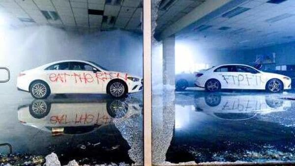 Vandalized cars sit in a Mercedes-Benz of Oakland showroom during in Oakland, California. (AP)
