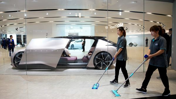 File photo: Cleaners are seen next to a self-driving electric concept car NIO Eve. (REUTERS)