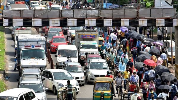 Huge traffic jam is seen on roads after people come out on roads in Kolkata on Friday. (ANI Photo)