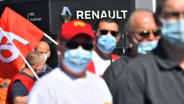 File photo: Workers and union members wear protective face masks during a protest outside the Renault SA auto plant in Maubeuge, France. (Bloomberg)