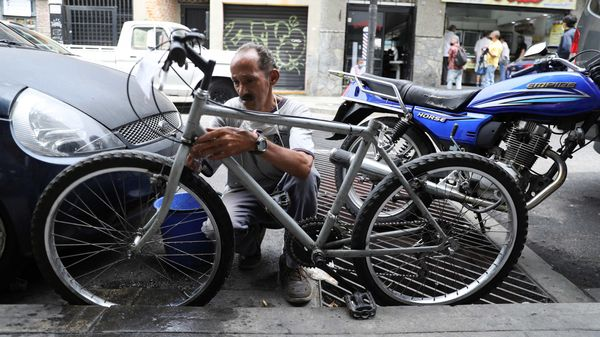 File photo: A man cleans a bicycle in a street in Caracas, Venezuela May 20, 2020. (REUTERS)