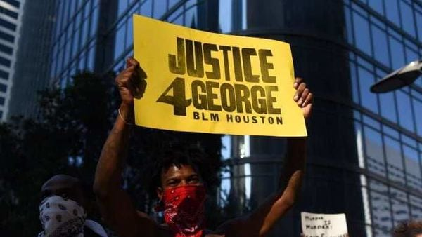 Protesters march at a rally against the death in Minneapolis police custody of George Floyd, in Houston, Texas, US