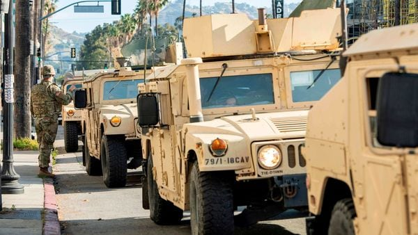 The National Guard patrol on Fairfax Avenue in Los Angeles, California. (AFP)