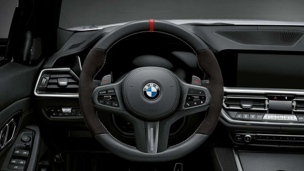 Inside the M440i xDrive, buyers can opt for the M Performance steering wheel finished in carbon fibre, with a red 12 o'clock mark and carbon fibre shift paddles.
