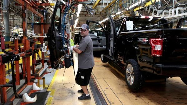 File photo: A Ford Motor assembly worker works on a 2018 Ford F150 pick-up truck at Ford's Dearborn Truck Plant in Michigan. (REUTERS)