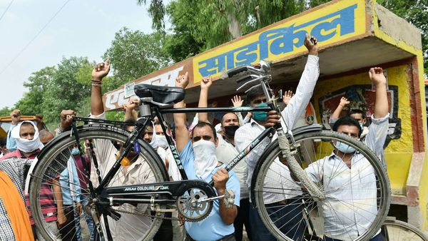 Ghaziabad: Workers shout slogans during a protest outside Atlas Cycles' factory. (PTI)