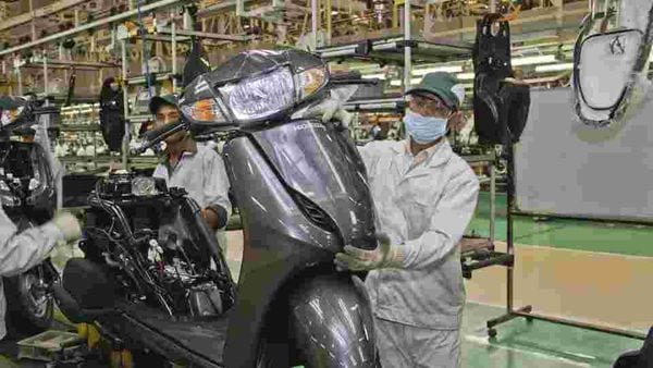 File photo of Honda Motorcycle and Scooter India (HMSI) workers at a facility after resuming work post lockdown.