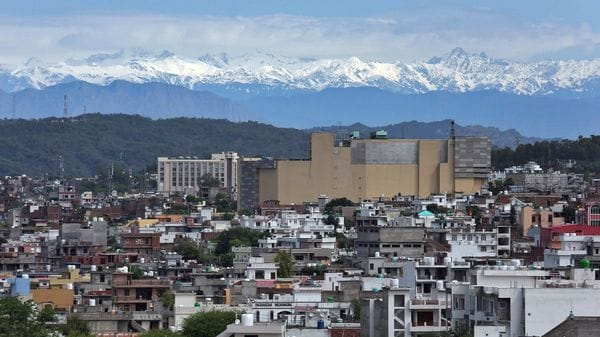 The snow-covered Pir Panjal mountain range is seen from a residential area after air pollution levels started to drop during a nationwide lockdown to slow the spreading of coronavirus disease (COVID-19), in Jammu May 3, 2020. (REUTERS)