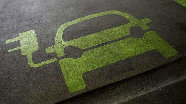 A sign is painted on a parking space for electric cars. (Representational File Photo)