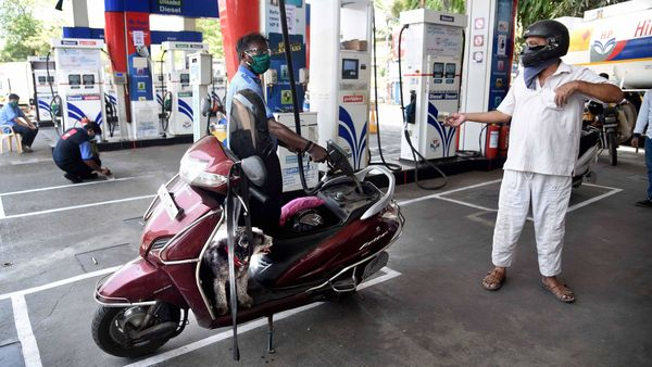 Navi Mumbai: An employee attends a customer at a petrol pump in APMC while maintaining social distancing, during the ongoing Covid-19 lockdown, in Navi Mumbai. (PTI)