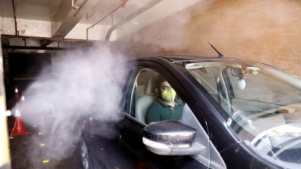A car is sanitised at the entrance of a mall as part of a demonstrated sanitisation procedure by mall authorities. (REUTERS)
