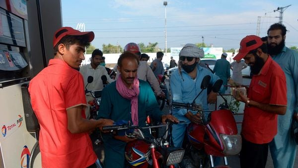 Commuters at a fuel station in Peshawar. (AFP)