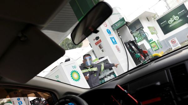 File photo: An employee of British Petroleum (BP) wearing a plastic shield, gives directions to the driver at the gas station, as the coronavirus disease continues in Mexico City. (REUTERS)
