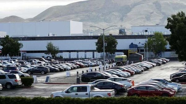A nearly full parking lot is seen outside Tesla's primary vehicle factory in Fremont, California. (REUTERS)