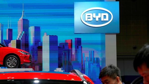 FILE PHOTO: Men clean a BYD electric vehicle (EV) e2 displayed during the media day for Shanghai auto show in Shanghai, China April 17, 2019. REUTERS/Aly Song/File Photo (REUTERS)