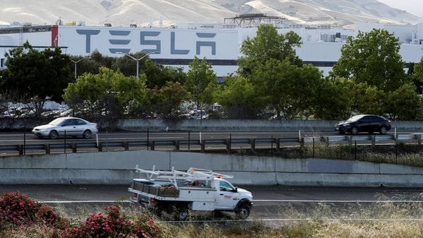 FILE PHOTO: Motorists drive past Tesla's primary vehicle factory after CEO Elon Musk announced he was defying local officials' restrictions against the spread of the coronavirus disease (COVID-19) by reopening the plant in Fremont, California, U.S. May 12, 2020. REUTERS/Stephen Lam/File Photo (REUTERS)