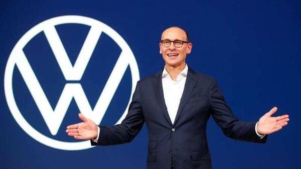 File photo: Ralf Brandstaetter, CEO of the Volkswagen Passenger Cars brand gestures in front of the revised logo of German carmaker Volkswagen. (Reuters)