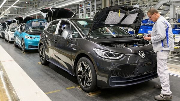 An employee works at a production line of the electric Volkswagen model ID.3 in Zwickau, Germany. (REUTERS)