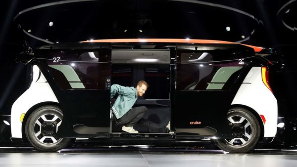 File photo: Kyle Vogt, chief technology officer, president and co-founder of Cruise stretches from a Cruise Origin autonomous vehicle during its unveiling. (REUTERS)