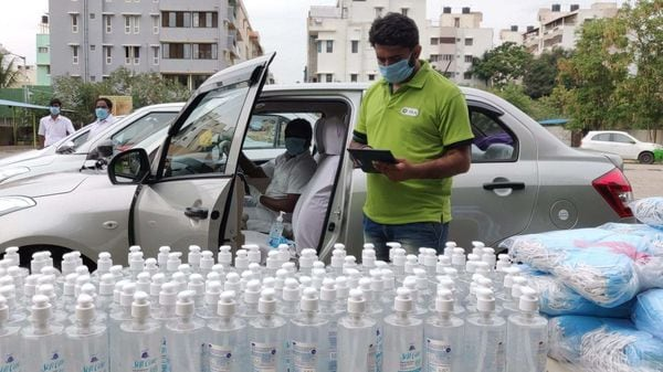 An Ola executive in Bangalore audits safety standards in waiting cars. (Photo courtesy: Ola)