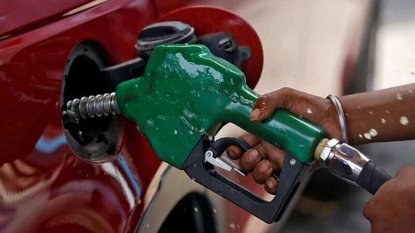 File photo: A worker holds a nozzle to pump petrol into a vehicle at a fuel station in Mumbai. (REUTERS)