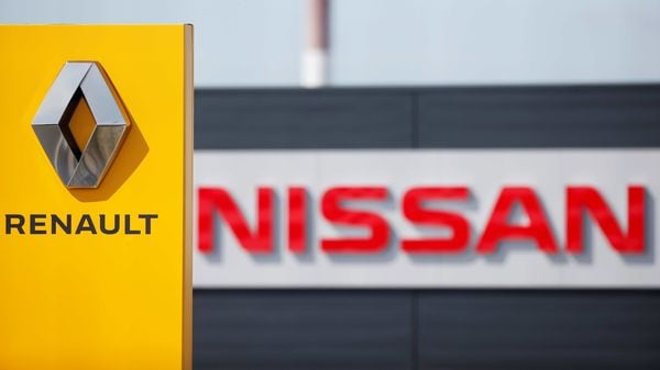 File photo: The logos of car manufacturers Renault and Nissan are seen in front of dealerships of the companies in France. (REUTERS)