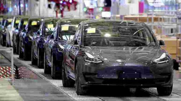 FILE PHOTO: Tesla China-made Model 3 vehicles are seen during a delivery event at its factory in Shanghai, China January 7, 2020. REUTERS/Aly Song (REUTERS)
