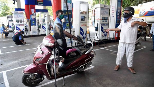 Navi Mumbai: An employee attends to a customer at a petrol pump in APMC while maintaining social distancing, during the ongoing Covid-19 lockdown. (PTI)